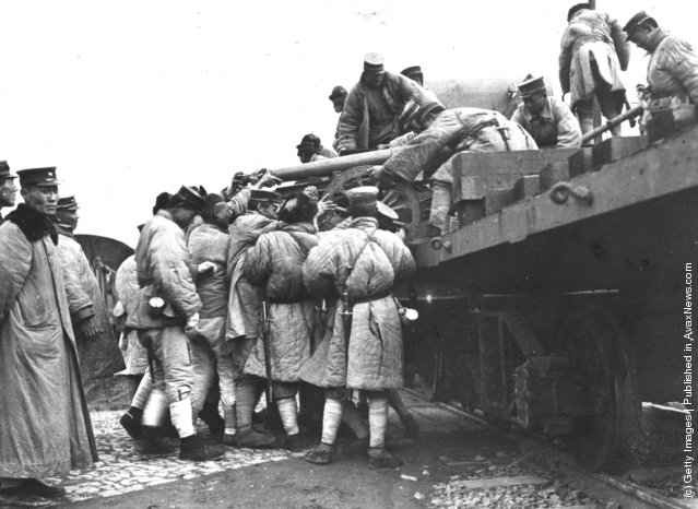 1927: Members of the North Chinese Shangtung forces load a gun on to an armoured train during the desertion of Shanghai in favour of Cantonese forces