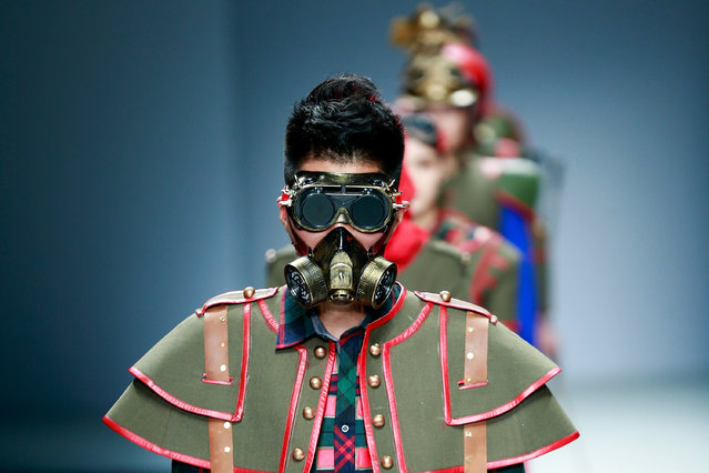 A model wear a mask showcases designs on the runway at Southwest University Graduates Show during the day five of China Graduate Fashion Week at the 751 D.Park Workshop on May 19, 2015 in Beijing, China. (Photo by Lintao Zhang/Getty Images)