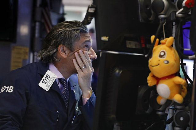 Trader John Romolo works on the floor of the New York Stock Exchange, Wednesday, May 29, 2019. Stocks are getting off to a weak start on Wall Street led by drops in technology and health care companies. (Photo by Richard Drew/AP Photo)