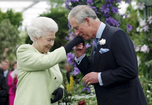 Britain's Prince Charles kisses the hand of his mother, Queen Elizabeth, during a visit to the Chelsea Flower Show in London in this May 18, 2009 file photo. (Photo by Sang Tan/Reuters)