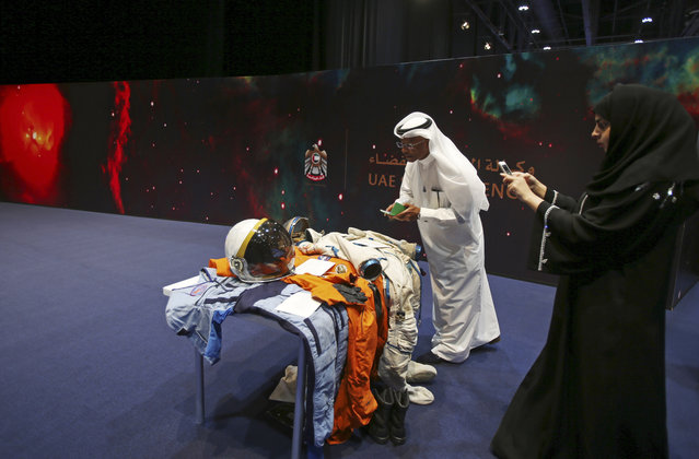 Emirati visitors take photos at the Space Museum during the launch of the UAE Space Agency strategic plan in Abu Dhabi, United Arab Emirates, Monday, May 25, 2015. The agency on Monday laid out a strategic framework for a newly created space agency that aims to integrate various arms of the Gulf federation's burgeoning space industry. (Photo by Kamran Jebreili/AP Photo)