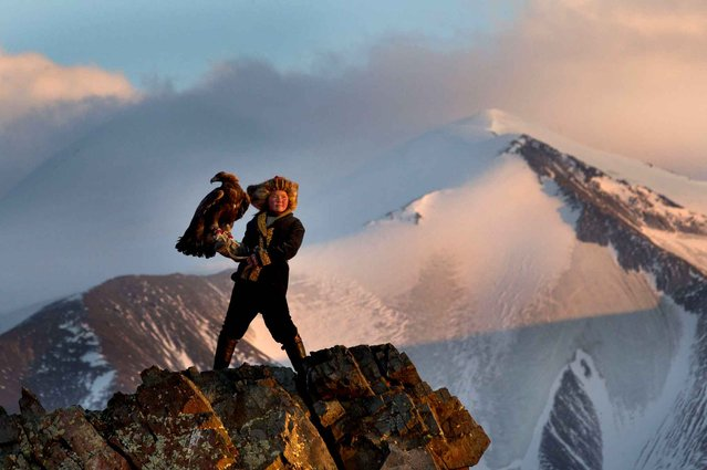 A young girl Ashol Pan (13) with his eagle in the mountains of the province of Bayan-Olgiy Mongolia. (Photo by Caters News)