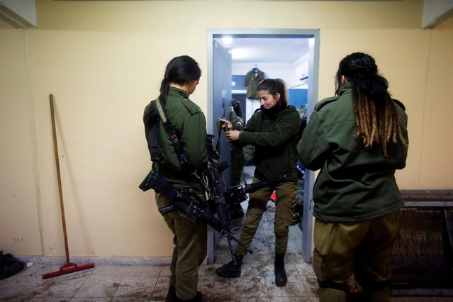Female Israeli soldiers from the Haraam artillery battalion stand in the women's living quarters at a military base in the Israeli-occupied Golan Heights March 1, 2017. (Photo by Nir Elias/Reuters)