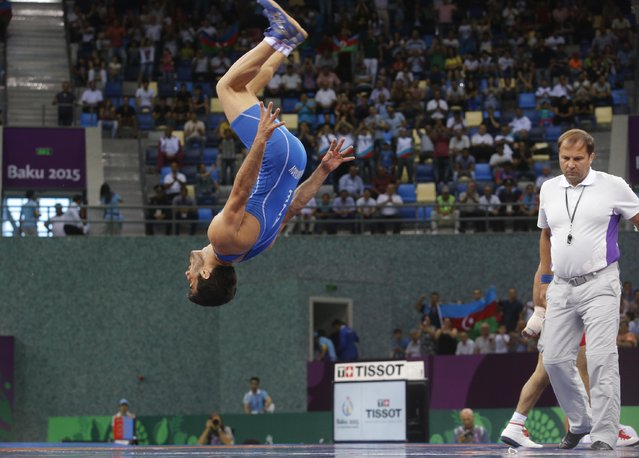 Elman Mukhtarov of Azerbaijan celebrates his victory over Roman Amoyan of Armenia in the the Men's wrestling, 59kg Greco-Roman Bronze Medal event at the 2015 European Games in Baku, Azerbaijan, Saturday, June 13, 2015. (AP Photo/Dmitry Lovetsky)