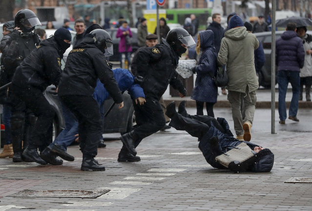 Belarus police push a woman down while detaining an activist during an opposition rally in Minsk, Belarus, Saturday, March 25, 2017. (Photo by Sergei Grits/AP Photo)