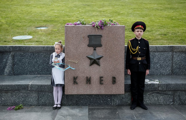 An young military cadet takes part in a ceremony to mark the 71st anniversary of the victory over Nazi Germany in World War Two in the World War Two museum in Kiev, Ukraine, May 6, 2016. (Photo by Gleb Garanich/Reuters)