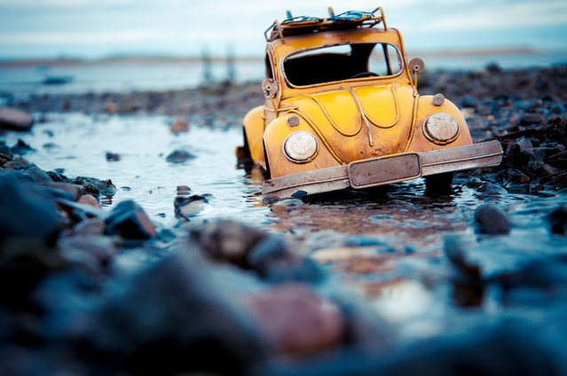 """An Irish Puddle"", Yellow Volkswagen Beetle, Malahide, Ireland, March 2013. (Photo by Kim Leuenberger)"
