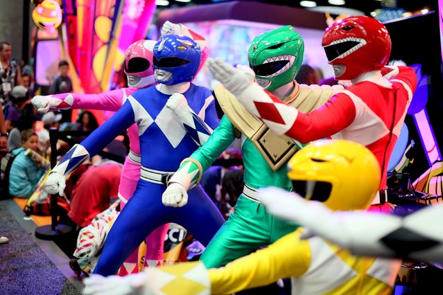 A group of Power Rangers pose inside the Convnetion Center at the 2015 Comic-Con International in San Diego, California July 9, 2015. (Photo by Sandy Huffaker/Reuters)
