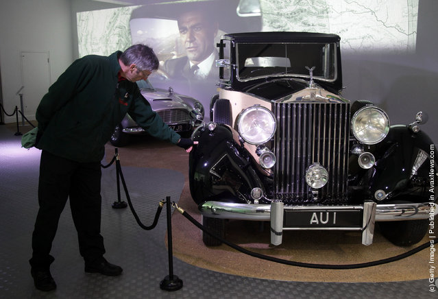A member of the musuem team attends to a Rolls-Royce Phantom III used in the James Bond film Goldfinger