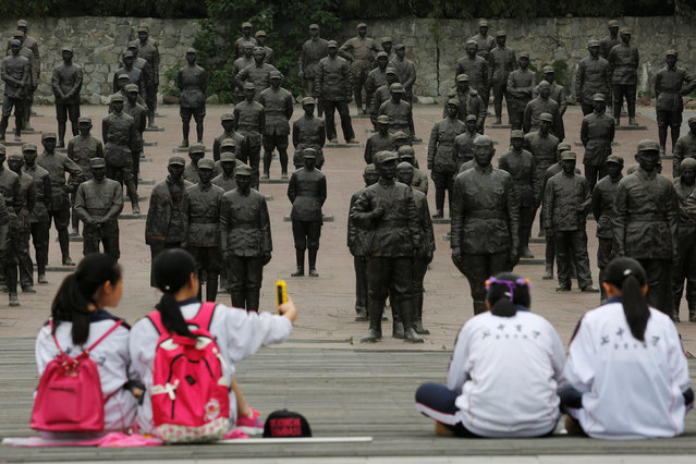 Students sit at the Chinese Heroes Statues Plaza, which displays war heroes from the War of Resistance against Japan, in Jianchuan Museum Cluster in Anren, Sichuan Province, China, May 13, 2016. (Photo by Kim Kyung-Hoon/Reuters)