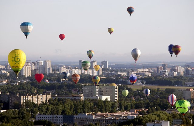 """Hot air balloons are seen at the Cup Hot Air event during the Air Sports festival titled """"70 Years of Peaceful Sky"""" in Minsk, Belarus July 18, 2015. (Photo by Vasily Fedosenko/Reuters)"""