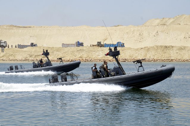 Security personnel cross through the New Suez Canal, Ismailia, Egypt, July 25, 2015. (Photo by Reuters/Stringer)