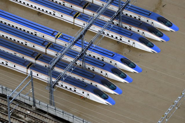 A Shinkansen bullet train rail yard is seen flooded due to heavy rains caused by Typhoon Hagibis in Nagano, central Japan, October 13, 2019. (Photo by Kyodo News via Reuters)