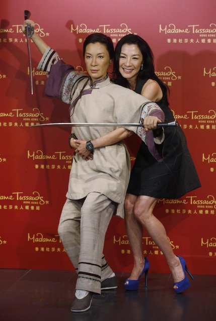"Malaysian martial arts actress Michelle Yeoh poses with her new wax figure at Madame Tussauds in Hong Kong, Monday, July 27, 2015. The wax figure is featuring a scene from the movie ""Crouching Tiger, Hidden Dragon"". (Photo by Kin Cheung/AP Photo)"