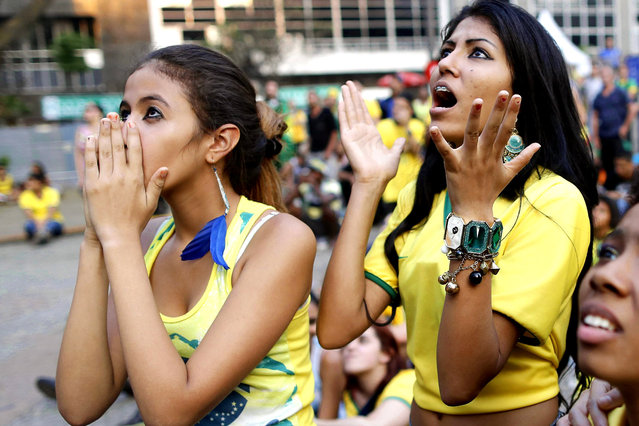 Brazilian fans react while watching the FIFA World Cup 2014 group A preliminary round match between Brazil and Mexico at the FIFA Fan Fest in Sao Paulo, Brazil, 17 June 2014. The match at the Estadio Castelao in Fortaleza ended 0-0. (Photo by Tolga Bozoglu/EPA)