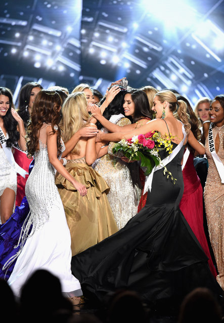 Constestants celebrate as Miss District of Columbia USA 2016 Deshauna Barber is crowned Miss USA 2016 during the 2016 Miss USA pageant at T-Mobile Arena on June 5, 2016 in Las Vegas, Nevada. (Photo by Ethan Miller/Getty Images)