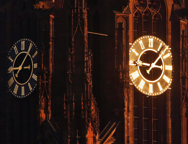 Sun light shines on one of the clocks on the cathedral in Frankfurt, Germany, on a cold and sunny Friday, January 6, 2017. (Photo by Michael Probst/AP Photo)