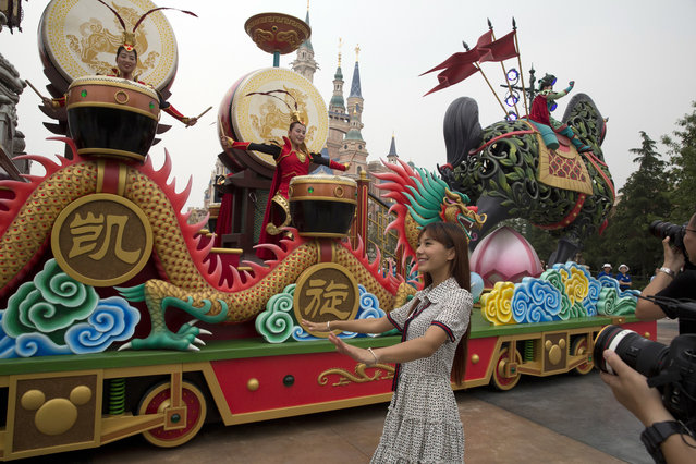 Characters from the Disney movie Mulan take part in a parade at the Disney Resort in Shanghai, China, Wednesday, June 15, 2016. (Photo by Ng Han Guan/AP Photo)