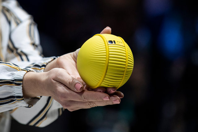 """The Samsung """"Ballie"""", an intelligent IoT device, is demonstrated at the manufacturer's booth during the 2020 International Consumer Electronics Show (CES) at the Las Vegas Convention Center in Las Vegas, Nevada, USA, 08 January 2020. (Photo by Etienne Laurent/EPA/EFE)"""