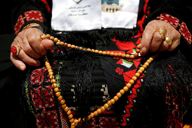 A Palestinian woman prays on the third Friday of the holy fasting month of Ramadan on the compound known to Muslims as Noble Sanctuary and to Jews as Temple Mount in Jerusalem's Old City June 24, 2016. (Photo by Ammar Awad/Reuters)