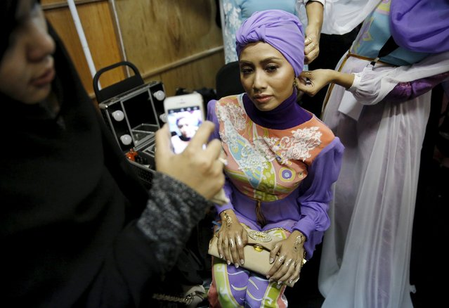 A model is photographed backstage during the Islamic Fashion Festival at Kuala Lumpur Fashion Week in Kuala Lumpur, Malaysia, August 13, 2015. (Photo by Olivia Harris/Reuters)