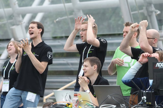 The team of the Technical University of Dortmund celebrates during a group match of the 20th RoboCup in Leipzig, Germany, June 30, 2016. (Photo by Sebastian Willnow/EPA)