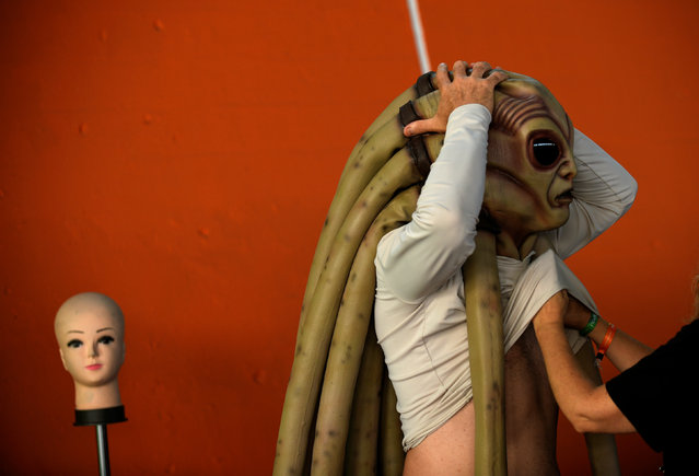 A cosplayer prepares before the start of the parade during the Metropoli (Media Culture and Entertainment Festival) in Gijon, northern Spain, July 3, 2016. (Photo by Eloy Alonso/Reuters)
