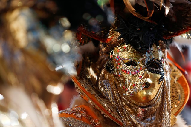 A masked reveller takes part in the carnival parade in Valletta, Malta on February 23, 2020. (Photo by Darrin Zammit Lupi/Reuters)