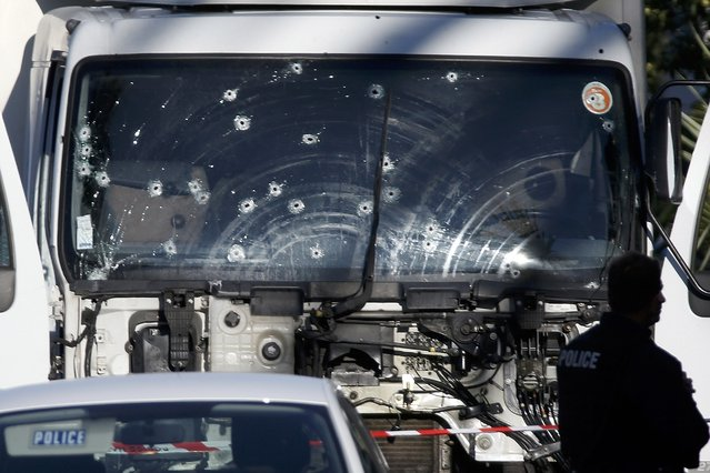 Bullet imacts are seen on the heavy truck the day after it ran into a crowd at high speed killing scores celebrating the Bastille Day July 14 national holiday on the Promenade des Anglais in Nice, France, July 15, 2016. (Photo by Eric Gaillard/Reuters)