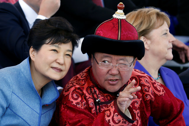 South Korean President Park Geun-hye listens to Mongolian President Tsakhiagiin Elbegdorj as German Chancellor Angela Merkel and other heads of delegations attend traditional nomadic Naadam festival performance during the Asia-Europe Meeting (ASEM) summit just outside Ulaanbaatar, Mongolia, July 15, 2016. (Photo by Bazarsukh Rentsendorj/Reuters)