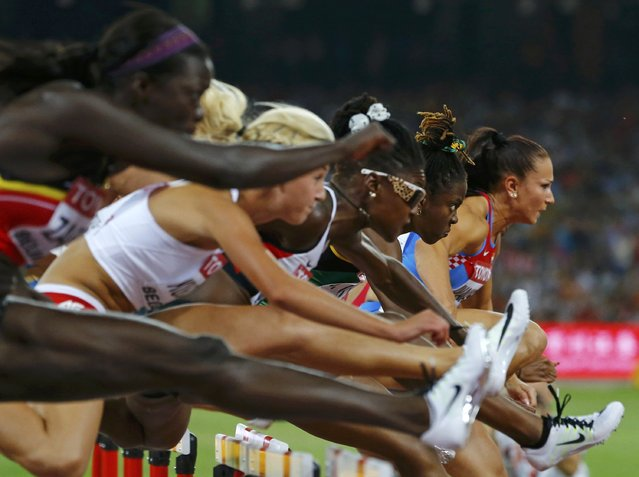Brianna Rollins of the U.S. (2ndR) clears a hurdle during her women's 100 metres hurdles semi-final during the 15th IAAF World Championships at the National Stadium in Beijing, China, August 28, 2015. (Photo by Damir Sagolj/Reuters)