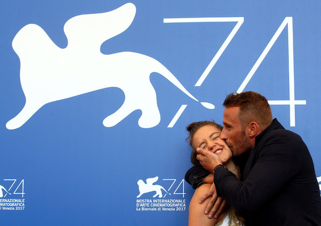 """Matthias Schoenaerts kisses Adele Exarchopoulos as they pose during a photocall for the movie """"Le Fidele"""" at the 74th Venice Film Festival in Venice, Italy on September 8, 2017. (Photo by Alessandro Bianchi/Reuters)"""