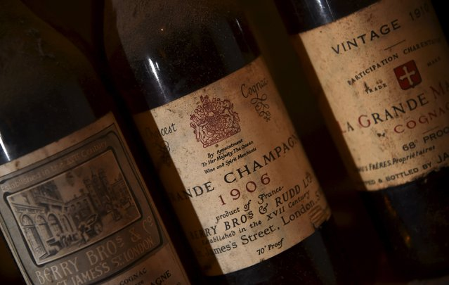 Bottles of vintage cognac, with a royal warrant stamp, are seen in storage inside Berry Bros and Rudd wine merchants in central London, Britain, August 21, 2015. Berry Bros. & Rudd, which started as grocers over 300 years ago in St. James's, central London, has two royal warrants. (Photo by Toby Melville/Reuters)