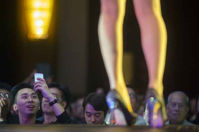 "Members of the audience watch contestants take individual spins on the catwalk. ""There is a lot of media attention on us for the pageant. As an actress who works in show biz, I want to be able to meet people and work with them"", said Xiren Wang. (Photo and caption by John Brecher/Sahra Vang Nguyen/NBC News)"