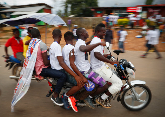 Supporters of Liberian presidential candidate George Weah ride five up, on a motorcycle during a campaign rally in Buchanan, Liberia, 30 September 2017 (issued 01 October 2017). Liberians will head to the polls on 10 October in the very first African nation to obtain independence in 1847. These elecions are hoped to be the first peaceful and democratic transfer of power from Africa's first woman democratically elected president, Ellen Johnson-Sirleaf to a new leader who has to continue in the efforts to rebuilding the country, following nearly two decades of brutal civil war. (Photo by Nic Bothma/EPA/EFE)