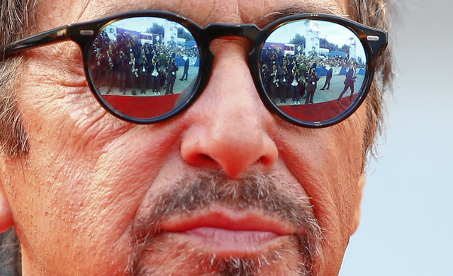 """Members of the media are reflected in the sunglasses of cast member Al Pacino as he attends the red carpet for the movie """"Manglehorn"""" at the 71st Venice Film Festival August 30, 2014. (Photo by Tony Gentile/Reuters)"""