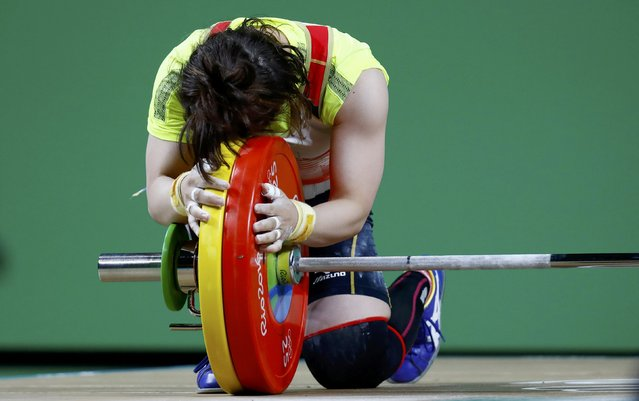2016 Rio Olympics, Weightlifting, Final, Women's 48kg, Riocentro, Pavilion 2, Rio de Janeiro, Brazil on August 6, 2016. Hiromi Miyake (JPN) of Japan embraces the weights after winning the bronze medal. (Photo by Kai Pfaffenbach/Reuters)
