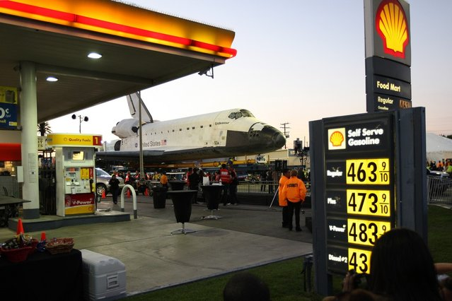 People gather as the space shuttle Endeavour is transported to the California Science Center in Exposition Park from Los Angeles International Airport (LAX) on October 12, 2012 in Los Angeles, California. (Photo by David McNew)