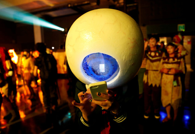 A participant in costume uses a mobile phone at a Halloween event in Kawasaki, south of Tokyo, Japan October 29, 2017. (Photo by Kim Kyung-Hoon/Reuters)