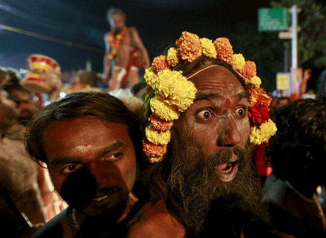 "A Naga Sadhus, or Hindu holy man, reacts to the camera during a procession before taking a dip in a holy pond during the second ""Shahi Snan"" (grand bath) at ""Kumbh Mela"", or Pitcher Festival, in Trimbakeshwar, India, September 13, 2015. (Photo by Danish Siddiqui/Reuters)"