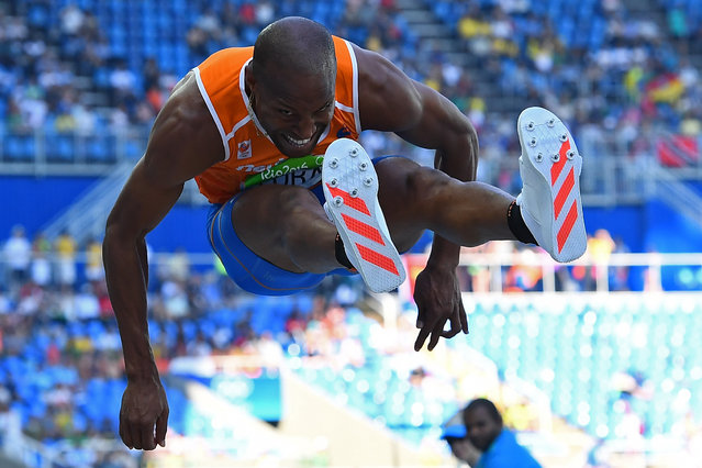 Netherlands' Fabian Florant competes in the Men's Triple Jump Qualifying Round as part of the athletics competition at the Rio 2016 Olympic Games at the Olympic Stadium in Rio de Janeiro on August 15, 2016. (Photo by Franck Fife/AFP Photo)