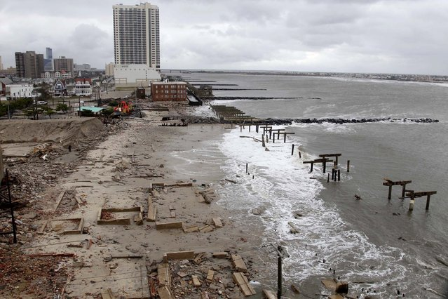 Foundations and pilings are all that remain of brick buildings and a boardwalk in Atlantic City, N.J. (Photo by Seth Wenig/Associated Press)