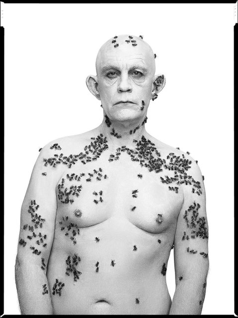 John Malkovich is seen in a re-creation of Richard Avedon's iconic photograph of beekeeper Ronald Fisher, taken on May 9, 1981, in Davis, Calif. (Photo by Sandro Miller/Catherine Edelman Gallery)