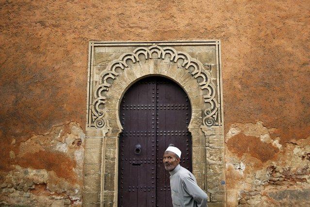 A man walks in front of doors in a wall of Rabat's Medina September 23, 2014. (Photo by Damir Sagolj/Reuters)