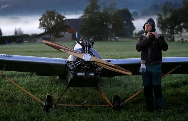 Aviator Frantisek Hadrava prepares before taking off with Vampira, an ultralight plane based on the U.S.-design of light planes called Mini-Max, near the village of Zdikov, Czech Republic, August 24, 2016. (Photo by David W. Cerny/Reuters)