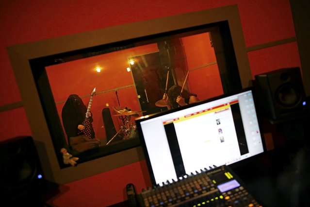 Gisele Marie, a Muslim woman and professional heavy metal musician, plays her Gibson Flying V electric guitar during a rehearsal at a studio in Sao Paulo January 13, 2015. (Photo by Nacho Doce/Reuters)