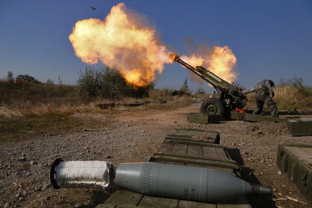 Pro-Russian rebels fire artillery toward Ukrainian position at Donetsk Sergey Prokofiev International Airport outskirts the city of Donetsk, eastern Ukraine Tuesday, October 14, 2014. (Photo by Dmitry Lovetsky/AP Photo)