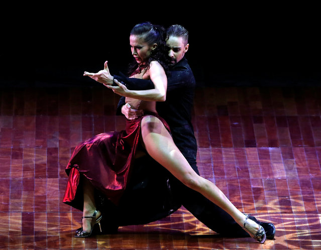Dimitri Kuznetsov and Olga Nikolaeva, from Russia, perform their routine on their way to win the third place at the Stage style Tango World Championship, in Buenos Aires, Argentina, August 31, 2016. (Photo by Enrique Marcarian/Reuters)