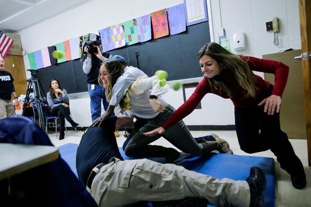 School teachers and staff members take part during an active shooter training at James I. O'Neill High School in Highland Falls, New York, U.S., December 12, 2017. (Photo by Eduardo Munoz/Reuters)
