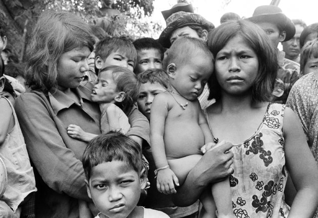 Mothers cradle their starved and sick children after escaping from Cambodia on October 5, 1979. The mothers said they had not eaten for five days. (Photo by Gary Mangkorn/AP Photo)